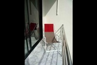 rental studio apartment ZEN 2 relaxs balcony to admire the coconut grove